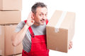 Mover guy making can`t hear you gesture Royalty Free Stock Photo