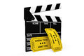 Movie clapper board and admit one tickets on a white background Royalty Free Stock Images