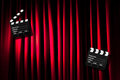 Movie clapper board against curtain Stock Photography