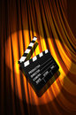 Movie clapper board against curtain Stock Images