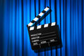 Movie clapper board against curtain Royalty Free Stock Photo