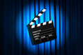 Movie clapper board against curtain Royalty Free Stock Photography