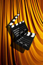 Movie clapper board against curtain Royalty Free Stock Image