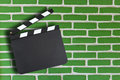 Movie clapper board blank production over brick wall background with copy space Royalty Free Stock Image