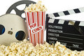 Movie Clapper Board in popcorn with film reel Royalty Free Stock Photo
