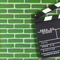 Movie clapper board production over brick wall background with copy space Stock Photos