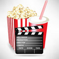 Movie clapper with popcorn and cola Stock Photos
