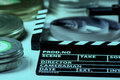 Movie cracker, rolls of film and a 35mm box films Royalty Free Stock Photo