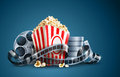 Movie film reel and popcorn Royalty Free Stock Photos