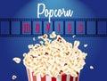 Movie film reel and popcorn Royalty Free Stock Photo