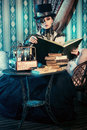 Movie hero portrait of a beautiful steampunk woman over vintage background Royalty Free Stock Photos