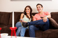 Movie night with my boyfriend happy hispanic couple having fun and watching tv in the living room Royalty Free Stock Photo