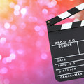 Movie production board clapper over romantic background with copy space Royalty Free Stock Images