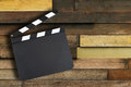 Movie production clapper board blank over vintage wooden wall with copy space Stock Photos