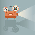 Movie projector on bule background Royalty Free Stock Photo