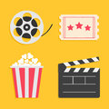 Movie reel Open clapper board Popcorn Ticket Cinema icon set. Flat design style. Yellow background. Royalty Free Stock Photo