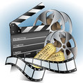 Movie related item set with clapper and film reels Stock Photography