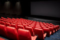 Movie theater or cinema empty auditorium entertainment and leisure concept with red seats Royalty Free Stock Photos