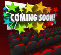 Movie theatre screen coming soon preview trailer new attraction a of red chairs and a with the words in d letters surrounded by Royalty Free Stock Photos