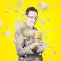 Movies man watching fall of cinema popcorn creative movie portrait a smiling the on bright yellow background films and Stock Images