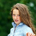 Moving into adulthood. Outdoor portrait of teenage girl. Royalty Free Stock Photo