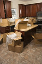 Moving boxes in kitchen. Stock Images