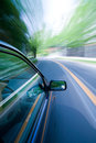 Moving car blurred view of the road and bend ahead from a fast Royalty Free Stock Photography