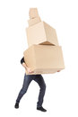 Moving day man lifting cardboard boxes stack on white with clipping path Royalty Free Stock Images