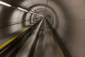 Moving fast through a modern, conrete tunnel Royalty Free Stock Photo