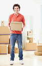 Moving in a handsome men holding a carboard box his hands Stock Photography