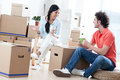 Moving in happy couple into a new apartment Royalty Free Stock Photo