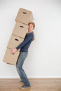 Moving Home - Woman Carrying Boxes Stock Images