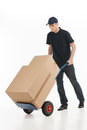 Moving house full length of young deliveryman with a hand truck transporting the cardboard boxes Royalty Free Stock Images