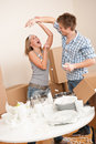 Moving house: Young couple having fun Stock Image