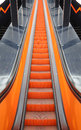 Moving staircase orange going up Stock Photography