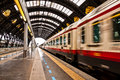 Moving train in motion at station departuring central milan italy blur effect of Royalty Free Stock Images