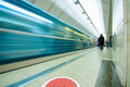 Moving train and passengers in subway station Royalty Free Stock Images