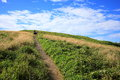 Pathway uphill with two women Royalty Free Stock Photo