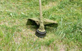 Mower close-up mowing green grass Royalty Free Stock Photo