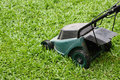 Mower running in the grass Stock Image