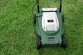 Mowers in the green field Stock Photography