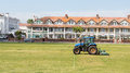 Mowing grass a corporation tractor being used to mow the in paignton devon united kingdom Stock Photo