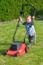 Mowing the lawn little boy Royalty Free Stock Image