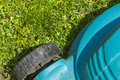 Mowing a lawn with mower Royalty Free Stock Photo