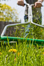 Mowing the lawn in spring Royalty Free Stock Photos