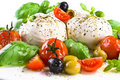 Mozzarella with basil cherry tomatoes and olives Stock Photos