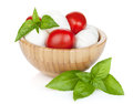 Mozzarella cheese with cherry tomatoes and basil isolated on white background Stock Photo