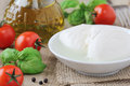 Mozzarella cheese delicious fresh balls of italian with cherry tomatoes basil and olive oil at the background Royalty Free Stock Photography