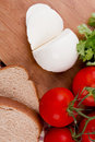Mozzarella cheese on a wooden plate healthy food Royalty Free Stock Photography