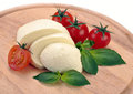 Mozzarella cherry tomatoes basil on a wooden board Royalty Free Stock Photography